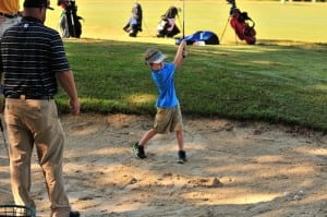 "A youngster takes a shot out of the ""Bunker Station"" at the Belmont Lake Golf Club during the Instructional Day"
